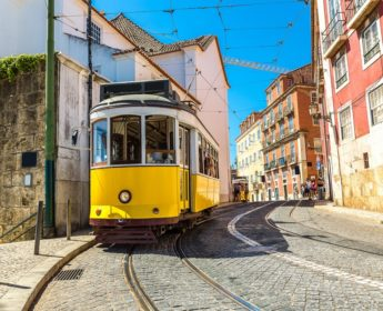 Tram running through Lisbon